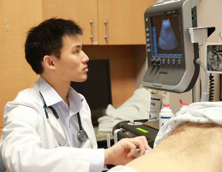 medical student performs ultrasound