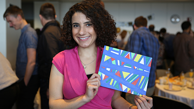 Graduating medical student Nancy Nasrawin displaying one of her art pieces