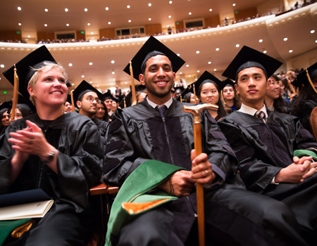 Walid Hamud, the Gold Cane Society Award recipient, sitting with fellow graduates