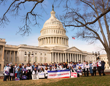 medical students gather in front of Capitol with #ProtectOurPatients signs