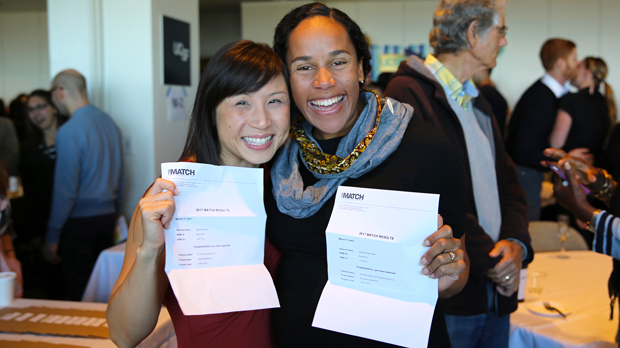 two students with Match letters