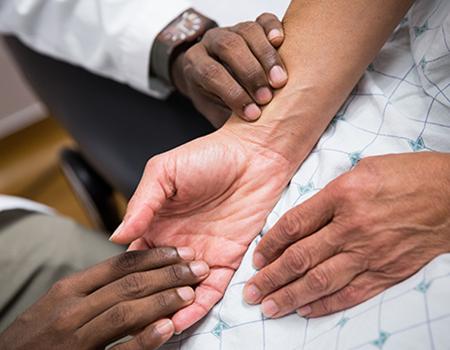 a student examining a patient