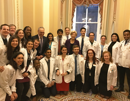 students with senators schumer and warren
