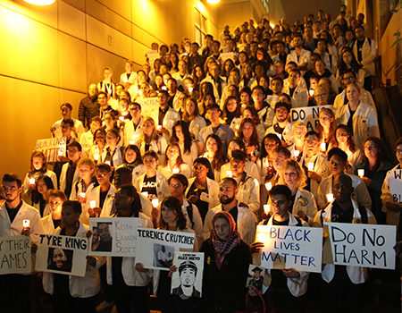 white coats for black lives vigil