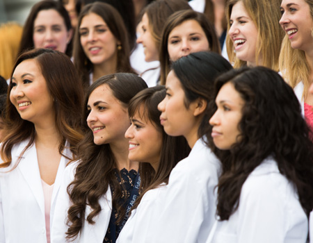 white coat group smiling