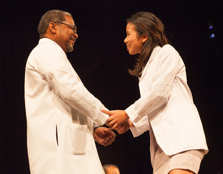 white coat ceremony handshake